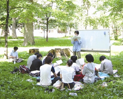 A literature reading session held on the Lawn of the School of Scienc
